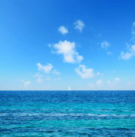 boat at the horizon with fata morgana effect, Sardinia