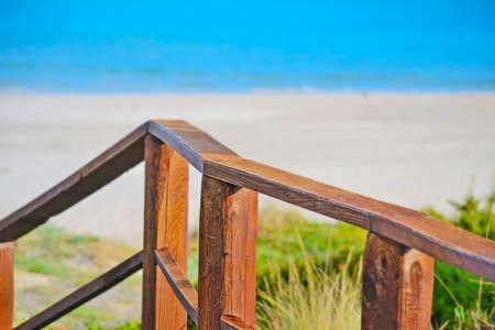 skim: wooden fence in La Pelosa beach, Sardinia