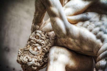 head close up: Centaur head  close up of Hercules and Nesso centaur statue in Loggia dei Lanzi in Florence, Italy
