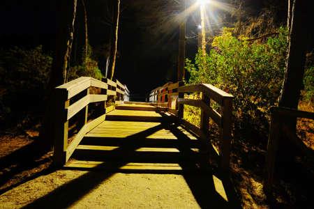 walkway: wooden boardwalk by night, Sardinia Stock Photo