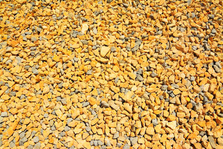 gravel: background made with yellow gravel close up Stock Photo