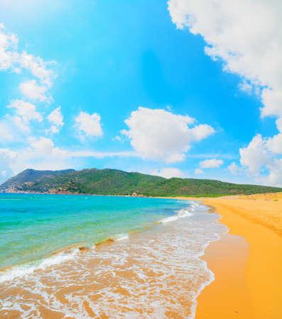 ferro: Porto Ferro beach under white clouds, Sardinia
