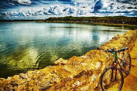 dirt path: mountain bike on a dirt path by Calik lagoon, Sardinia Stock Photo