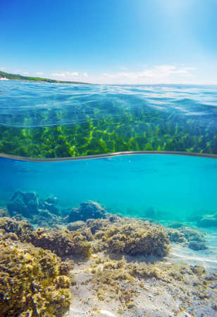under surface: over and under water surface of a Sardinian beach, Italy Stock Photo