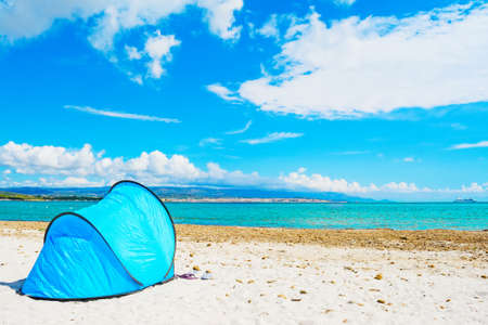 blue tent by the sea in Alghero, Sardinia