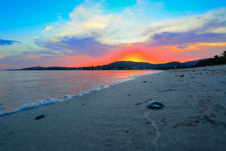 mapped: colorful sunset in Maria Pia beach, Sardinia