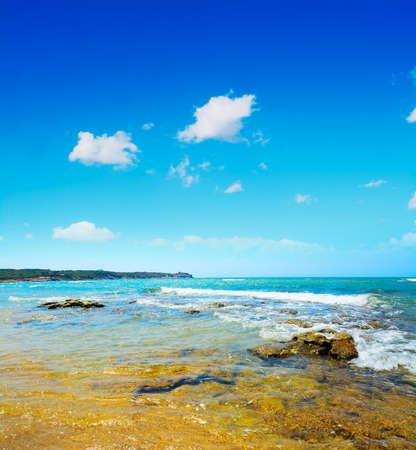 ferro: rocks and sand in Porto Ferro, Sardinia Stock Photo