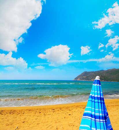 ferro: closed parasol in Porto Ferro beach, Sardinia
