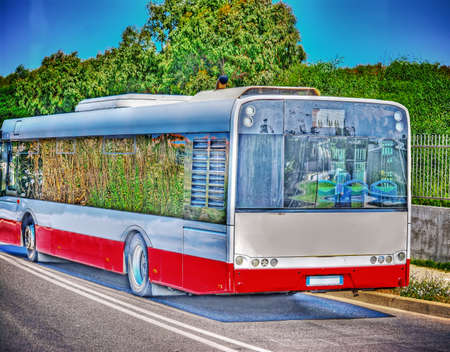 route master: side view of a bus in  hdr tone mapping effect