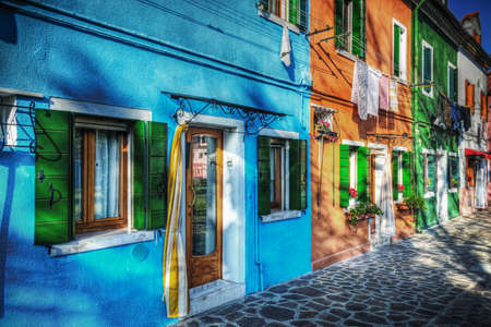 backstreet: colorful backstreet in Burano, Italy. Processed for hdr tone mapping effect. Stock Photo