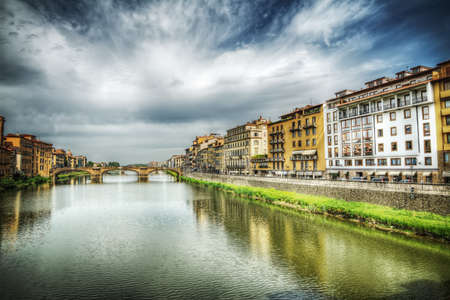 arno: Arno river under a dramatic sky in Florence, Italy