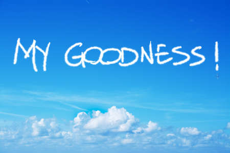 goodness: my goodness written in the sky with an airplane contrail