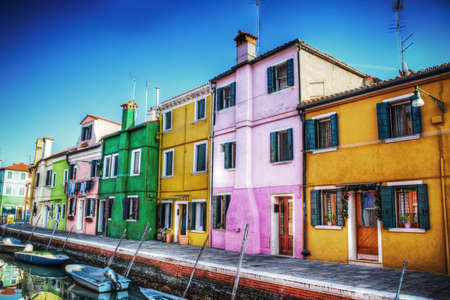 burano: houses by a canal in Burano, Italy