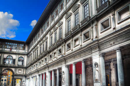 historical sites: Uffizi Gallery in Florence under a blue sky with clouds