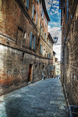 backstreet: narrow backstreet in Siena, Italy Stock Photo
