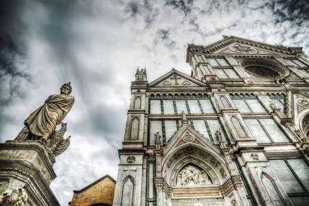 dante alighieri: XIX century Dante Alighieri statue and Santa Croce cathedral in Florence, Italy Stock Photo