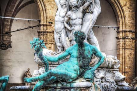 faun: bronze faun in Neptune fountain in Florence, Italy