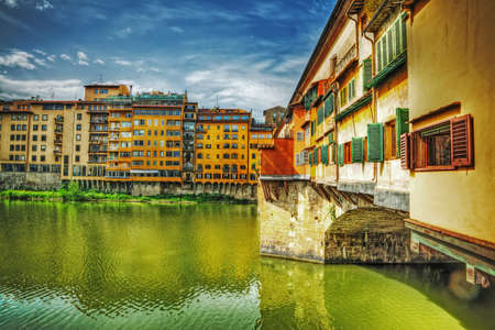 arno: Ponte Vecchio seen from Arno bank in Florence, Italy