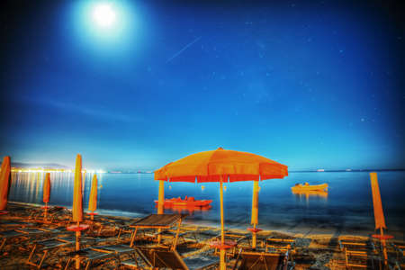 mapped: umbrella under a starry sky in Alghero, Italy