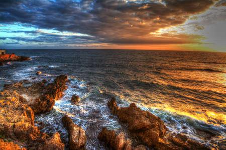rocky coastline: colorful sunset in Alghero rocky coastline, italy Stock Photo