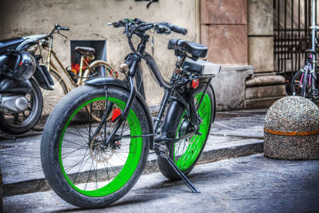 parked bikes: fat bike parked in Florence, Italy Stock Photo