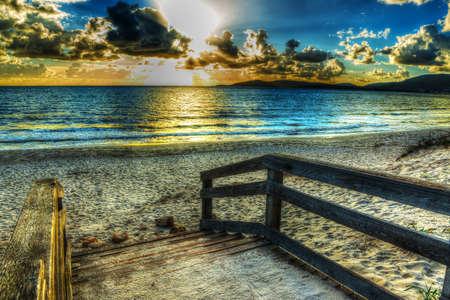 seascape: wooden boardwlak on the sand in Alghero, Sardinia Stock Photo