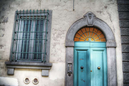 window grill: old door and window with metal grill in Florence, Italy