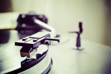 stylus: record player stylus on a rotating disc Stock Photo