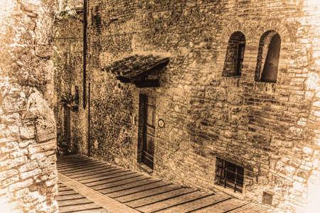 discolored: narrow backstreet in San Gimignano in vintage tone, Italy