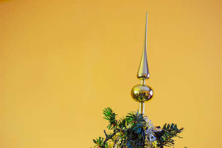 topper: Christmas tree topper on a golden background Stock Photo