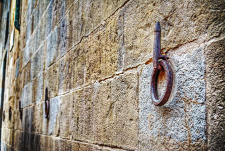 iron hoops: Ancient iron hoop hanging on stone wall in Florence, Italy Stock Photo