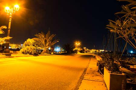 wharf: wharf in Alghero harbor by night, Italy