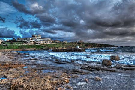 skim: Alghero shoreline on a cloudy day, Italy Stock Photo