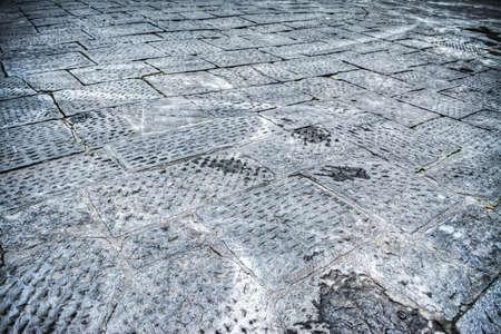 empedrado: Primer plano de un suelo enlosado en Florencia, Italia
