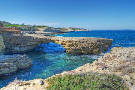 torres: rocky coast in Porto Torres, Italy Stock Photo