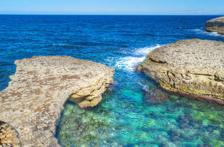torres: rocky shore in Porto Torres, Sardinia