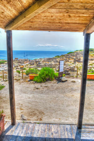 phoenicians: wooden canopy by the sea in Tharros, Italy