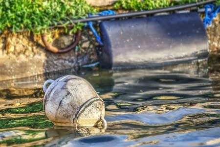 buoy: white buoy on the water in Sardinia, Italy Stock Photo