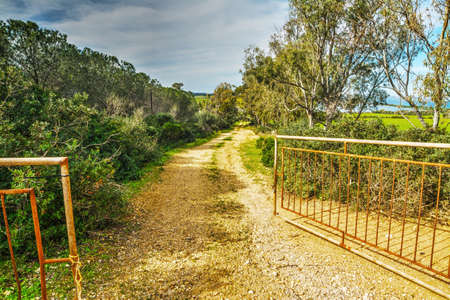 open gate: open gate in the countryside, Sardinia