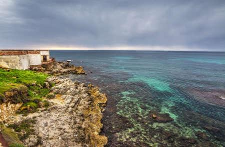 grey  sky: grey sky over Alghero shoreline at sunset, Sardinia