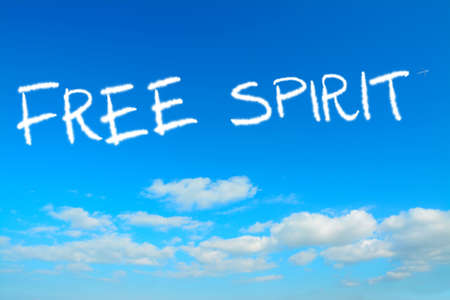free spirit: free spirit written in the sky with contrails Stock Photo