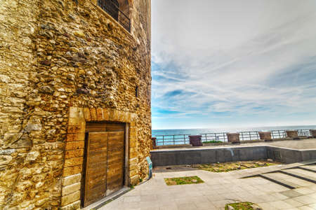 sighting: sighting tower in Alghero promenade, Italy Stock Photo