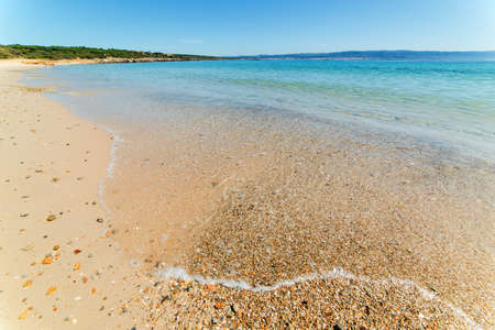 foreshore: pebbles on the foreshore in Lazzaretto beach, Sardinia