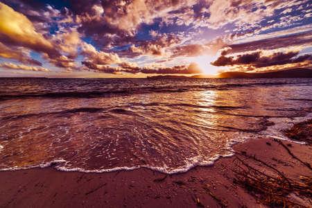 foreshore: Alghero foreshore at sunset, Italy Stock Photo