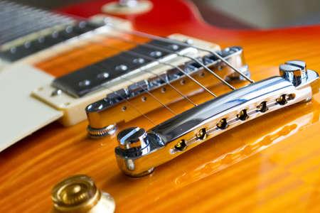 close up of an electric guitar bridge
