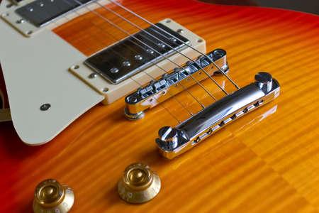 chromed: close up of chromed electric guitar bridge