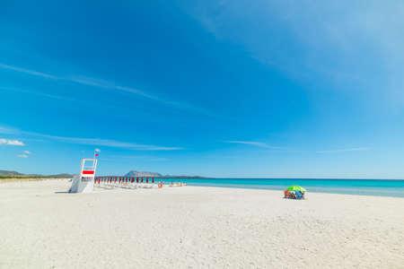 parasol on the beach under a blue sky, Sardinia