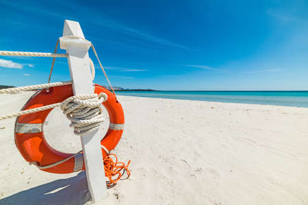 close up of a life buoy in a tropical beach, Sardinia Stock Photo