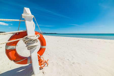 beach buoy: close up of a life buoy in a tropical beach, Sardinia Stock Photo
