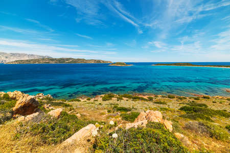 capo: Landscape of Capo Coda Cavallo under white clouds, Sardinia Stock Photo